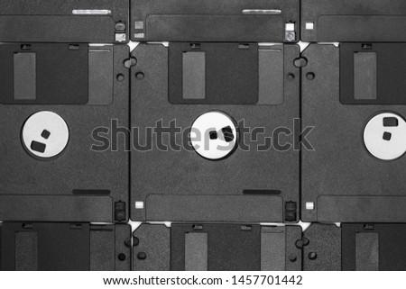Background of bunch black floppy disks #1457701442