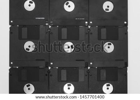 Background of bunch black floppy disks on white background #1457701400
