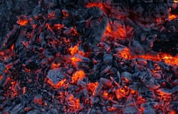 Background of burning hot coals. Burning coals in the brazier.