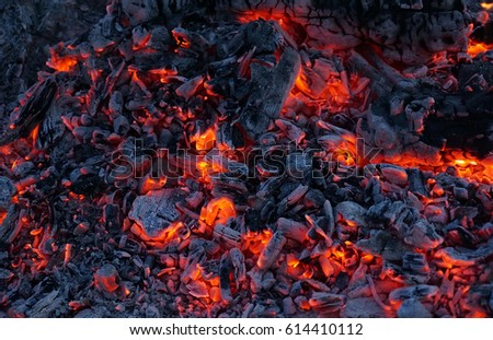 Background of burning hot coals. Burning coals in the brazier.  #614410112