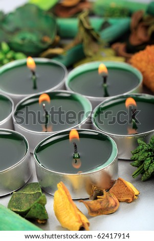 Background of burning tea light candles with decorative petals