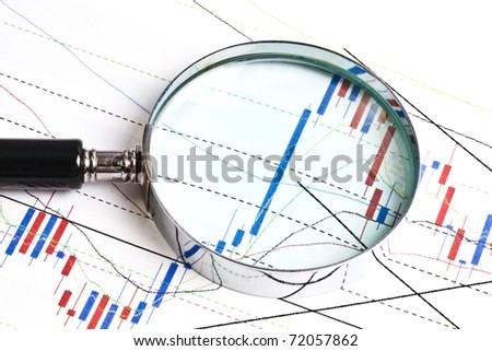 Background of business graph and a magnifier