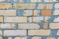 background of careless laying of a brick wall smeared with cement mortar. cement mortar drips on a brick wall