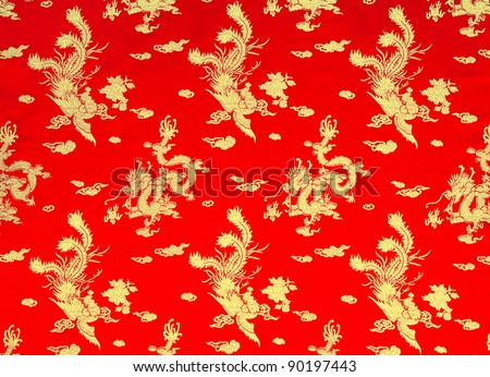 Background of chinese red silk with dragon and phoenix