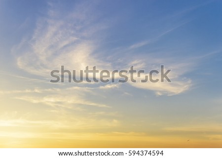 Background of cirrus clouds on the blue sky at golden sunset #594374594