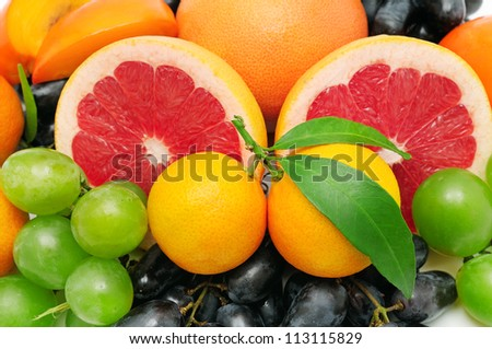 background of citrus, grapes, and other fruits - stock photo