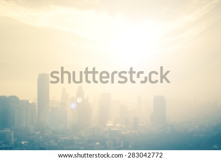 Background of cityscape concept: Blurred aerial view building big city on amazing golden warm light at sunrise