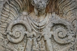 Background of closeup of beautiful Roman or Greek male stylized angel with cracks and face crumbled off - beautiful and grungy