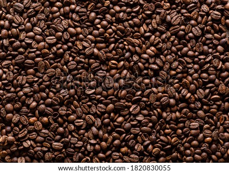 Background of coffee beans. Texture of brown roasted coffee beans.   Foto d'archivio ©