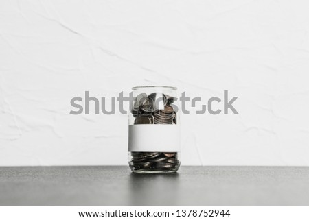 Background of coins stacks in pig jar with empty label banner profession business saving plan for family invest long-term in retirement real estate, wealth management investment