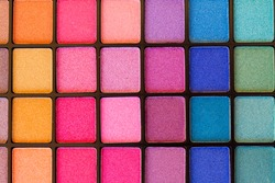 background of colorful blue, pink and green eye shadows palette