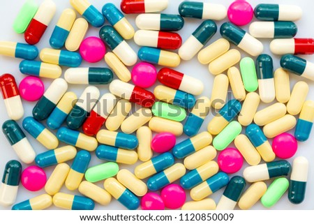 Background of colorful pills and medication, health and medication concept #1120850009