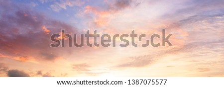 Background of colorful sky concept: Dramatic sunset with twilight color sky and clouds ストックフォト ©