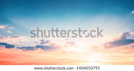 Photo of  Background of colorful sky concept: Dramatic sunset with twilight color sky and clouds