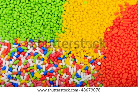 Background of colorful sprinkles, jimmies for cake decoration or ice cream topping