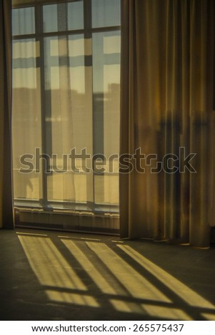 background of Contrast sun light from a window from window frame with curtains Sunset rays on stone floor texture on empty backdrop