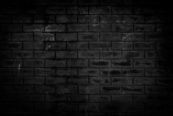 Background of dark brick wall pattern texture.
