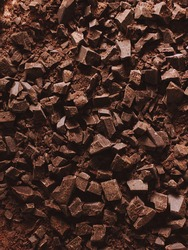 Background of dark chocolate chopped. Texture of chocolate with copy space.