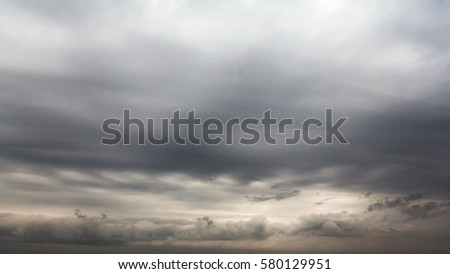 Background of dark clouds. A dramatic autumn sky with gray dense clouds before downpour. #580129951