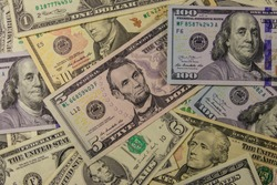Background of different dollar banknotes