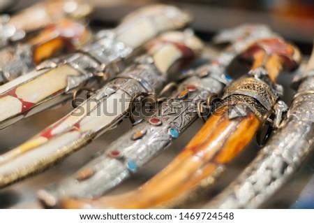 Background of different oriental daggers in a souk. / Oriental daggers