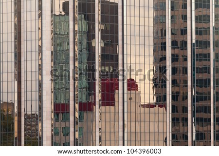 Background of distorted reflections of a cityscape in a modern coporate glass-walled building facade - stock photo