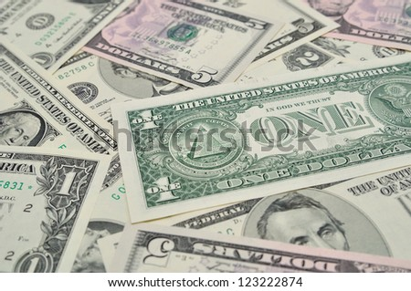 Background of dollar banknotes, with selective focus.