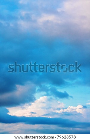 Background of dramatic blue sky with cumulus clouds