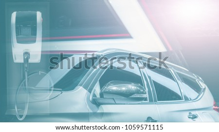 Background of electric vehicle with EV charger station in concept of modern technology of high efficiency automoble fuel system Zdjęcia stock ©