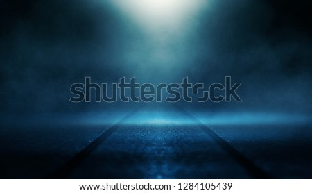 Background of empty dark room with rays of light. Concrete floor with light reflection. Smoke, neon blue light #1284105439