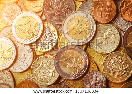 Background of Euro coins money.United kingdom Pound coin.US coins.Group of coins Foto d'archivio ©