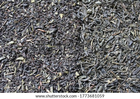 background of food tea black and green are scattered evenly with additives