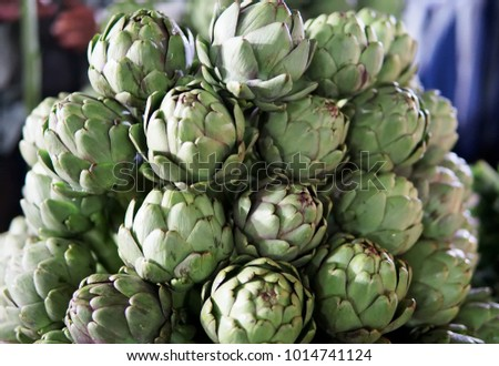 Background of fresh artichokes. Background of fresh artichokes. Fresh artichokes on display at the farmers' market for sale. #1014741124