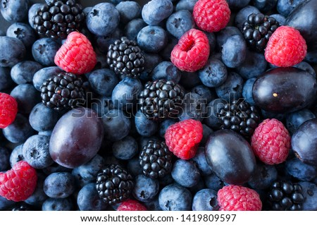Background of fresh fruits and berries. Ripe blackberries, blueberries, plums, raspberries. Mix berries and fruits. Top view. Background berries and fruits. Black-blue and red food. #1419809597