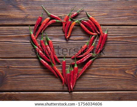 background of fresh red chili pepper arranged into heart shape. Top view Stock foto ©