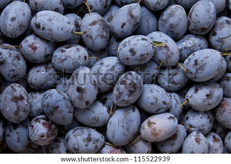 Background of fresh ripe healthy plums