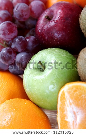 background of fruits like apples, grapes, oranges