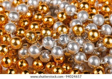 Background of gold and silver christmas beads