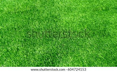 Background of green grass artificial field - Shutterstock ID 604724153