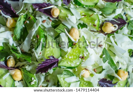 Background of green salad with sprouted chickpeas. Vegetarian raw food.