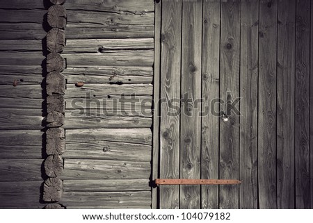Background of grey wall of ancient weathered wood with rusty metal details