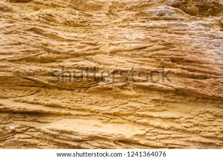 Background of grooved sandstone