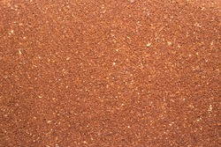 Background of ground insoluble coffee close-up. Texture of ground coffee