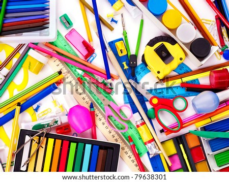 Background of group school supplies.