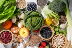 Background of healthy food and clean eating with fruit, vegetable, superfood, leaf vegetable. Soft focus.