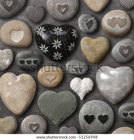 Background of heart-shaped things made of stone and rock.