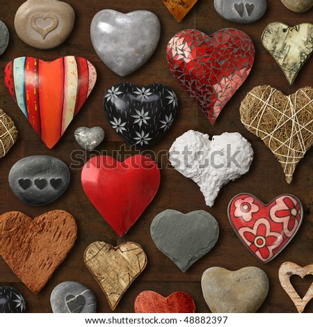 Background of heart-shaped things made of stone, metal and wood.