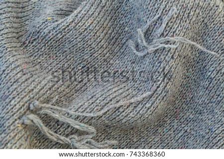 background of knitted gray linen of goat's wool made with knitting needles or on a knitting machine laid in big waves. #743368360