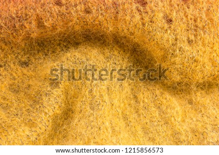 background of knitted shawl in yellow mohair and silk wool