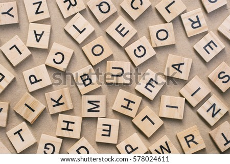 background of  letterpress wood type printing blocks, random letters of alphabet and punctuation stained by black inks #578024611